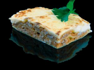 Meat lasagna with bechamel sauce and cheese