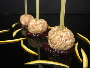 Goat cheese and sesame lollipops