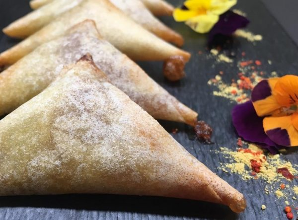 Foie gras and quince triangles