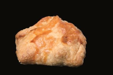 Dates and almonds stuffed pork tenderloin puff pastry