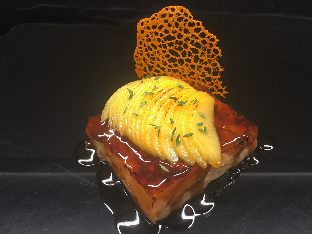 Slab of suckling pig with lagavulin reduction caramelized peach and crispy pumpkin
